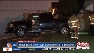 Truck slams into Tulsa home