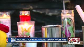 Vigil held for family found dead in house fire