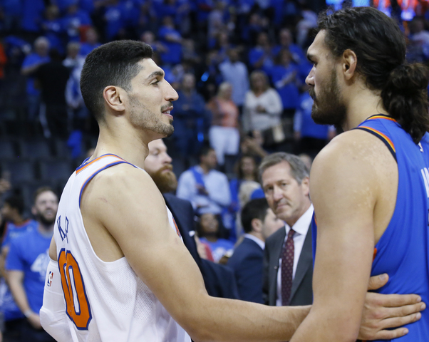 New York Knicks center Enes Kanter, left, talks with former teammate Oklahoma  City Thunder center Steven Adams, right, following an NBA basketball game  in ...